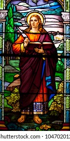 TORONTO, CANADA - MAY 26: The stained glass window with religious motif at Corpus Christi church in Toronto on May 26, 2012