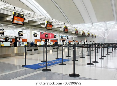 TORONTO, CANADA - MAY 29, 2014: Check-in counters at Pearson International Airport in Toronto, Ontario, Canada. Pearson is the largest and busiest airport in Canada.