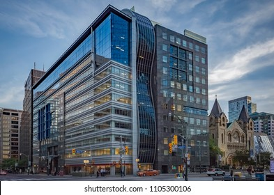 TORONTO, CANADA - MAY 29, 2018: University Avenue and King Street West Intersection.Toronto's Financial District; CIBC Bank , Canadian Blood Services, St. Andrew's Church and a subway station