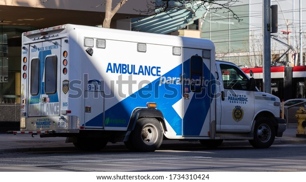 TORONTO, CANADA - May 7, 2020: Toronto Paramedic Services Ambulance parked in downtown Toronto while responding to a call.
