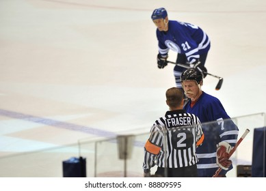 TORONTO, CANADA - NOV 13:  Lanny McDonald is interviewed by Kerry Fraser as Salming watches during the Hockey Hall of Fame Legends Classic game played at the Air Canada Centre on Nov 13, 2011 in Toronto, Canada