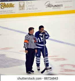 TORONTO, CANADA – NOV 13: Referee Kerry Fraser talks to Hall of Famer Doug Gilmour before interview during Hockey Hall of Fame Legends Classic game on Nov 13, 2011 in Toronto, Canada.