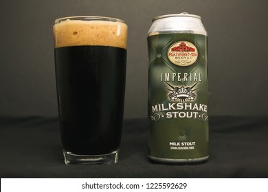 TORONTO, CANADA - NOV 9, 2018: Imperial Milkshake Stout by Rochester Mills Beer Company. Retail can and poured glass.