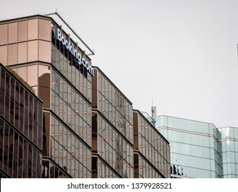 TORONTO, CANADA - NOVEMBER 12, 2018: Booking.com logo in front of one of their main office for Canada in Toronto. Booking is a hotel and travel search enging and reservation website