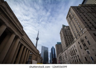 TORONTO, CANADA - NOVEMBER 13, 2018: View of the Canadian National Tower (CN Tower) seen from Union Station in Toronto, Ontario. These two buildings are among the most iconic of the city