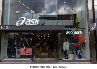 TORONTO, CANADA - NOVEMBER 13, 2018: Asics logo in front of their local store in downtown Toronto, Ontario. Asics is a japanse sportswear and footwear brand specialized in shoes