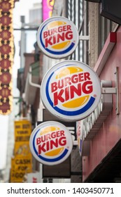 TORONTO, CANADA - NOVEMBER 13, 2018: Burger King logo on their main fast food restaurant for Toronto, Ontario. Burger King is an american fast food restaurant brand and franchise spread worldwide