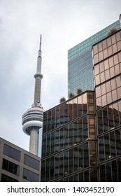 TORONTO, CANADA - NOVEMBER 13, 2018: Canadian National Tower (CN Tower) surrounded by modern skyscrapers in Toronto. CN Tower is the tallest building of the capital of Ontario, and one of landmarks