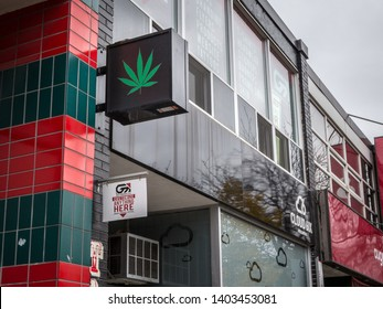 TORONTO, CANADA - NOVEMBER 13, 2018: Cannabis leaf shaped logo in front of a store selling weed. Since 2018, Recreational use of marijuana and weed is legalized in all provinces of Canada
