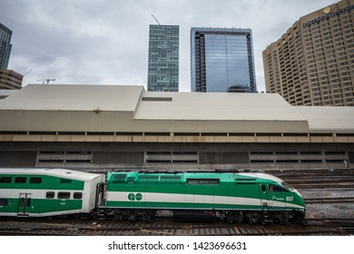TORONTO, CANADA - NOVEMBER 13, 2018: Go Transit train leaving Union station whith skyscrapers in background. Go Transit is the commuter transit system of Toronto & Ontario