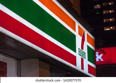 TORONTO, CANADA - NOVEMBER 14, 2018: 7 Eleven logo in front of their local shop in Spadina avenue in Toronto. 7-Eleven is an American brand of convenience stores spread worldwide