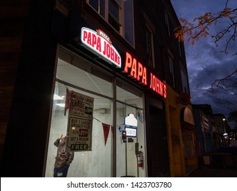 TORONTO, CANADA - NOVEMBER 14, 2018: Papa John's logo in front of their local fast food in Toronto, Ontario. Papa Johns Pizza is an American braind of Pizza and pizzeria restaurants