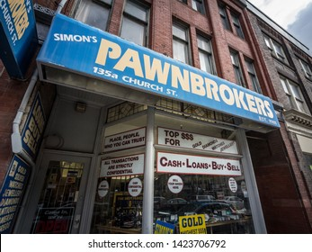 TORONTO, CANADA - NOVEMBER 14, 2018: Pawnbroker main entrance in downtown Toronto. A Pawn Shop is a business offering loans & money in exchange of objects than can be sold as collaterals