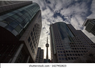 TORONTO, CANADA - NOVEMBER 14, 2018: Canadian National Tower (CN Tower) surrounded by modern skyscrapers in Toronto. CN Tower is the tallest building of the capital of Ontario, and one of landmarks