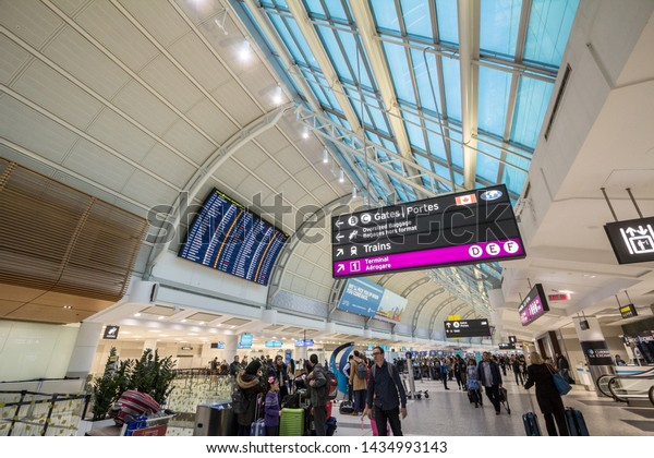 TORONTO, CANADA - NOVEMBER 14, 2018: Departures board and check in gates of Terminal 2 of Toronto Pearson Airport, the main busiest international airport of Canada and Ontario
