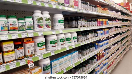 TORONTO, CANADA - NOVEMBER 16, 2017: Vitamins and nutrients on sale at a supermarket shelf.