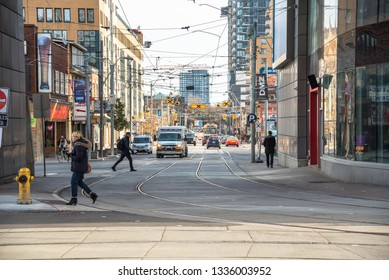 Toronto, Canada - November, 17 2017: Traffic in Dundas Street East on a Sunny Autumn Morning. Dundas Street is one the few east - west routes to run uninterrupted through the Greater Toronto Area.