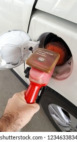 TORONTO, CANADA - NOVEMBER 18, 2018: Fuel filling of a vehicle at a gas station in Toronto, Canada.