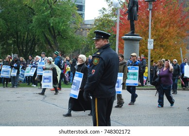 TORONTO, CANADA: November 2 2017 - Police Officer And Protesters, Education Reform Rally At Queens Park, Government Building Protest With Students Who Cannot Afford University And College Studies