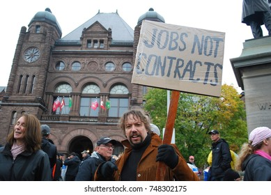 TORONTO, CANADA: November 2 2017 - Man Holding Jobs Sign, Education Reform Rally At Queens Park, Government Building Protest With Students Who Cannot Afford University And College Studies