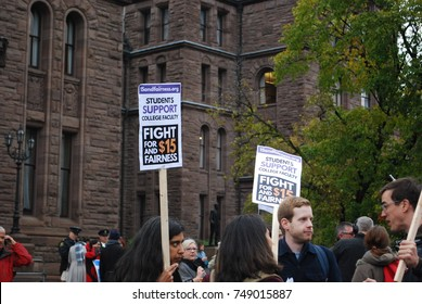 TORONTO, CANADA: November 2 2017 - $15 Minimum Wage Protest Sign, Rally At Queens Park, Government Building Protest, Students Who Cannot Afford University And College, Minimum Wage Political Problems