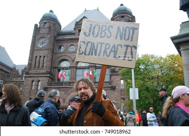 TORONTO, CANADA: November 2 2017 - Man Holding Sign, Reform Rally At Queens Park, Government Building Protest With Students Who Cannot Afford University And College Studies, Jobs, Unemployment