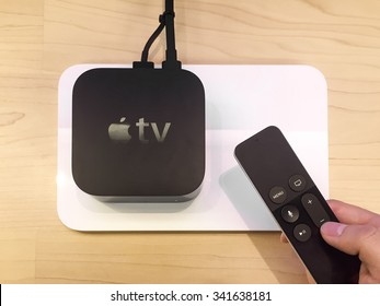 TORONTO, CANADA - NOVEMBER 20, 2015:  Customer hands on the new Apple TV at the Apple Store.