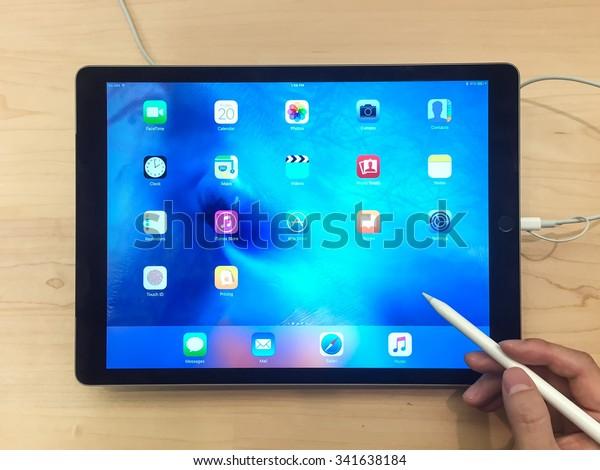 TORONTO, CANADA - NOVEMBER 20, 2015:  Customer hands on the new iPad Pro at the Apple Store.