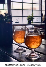 Toronto, Canada - November 23, 2019 : Two glasses of craft beer in the taproom of Rainhard Brewing Company, in the historic stockyards district