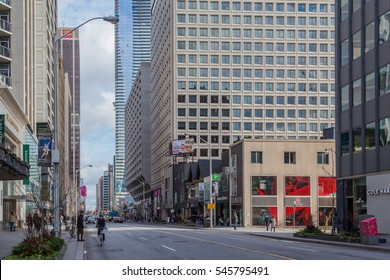 TORONTO, CANADA -  NOVEMBER 26, 2016: People in Bloor-Yorkville shopping district in Toronto. Bloor-Yorkville district is one of Canada's most exclusive shopping districts.