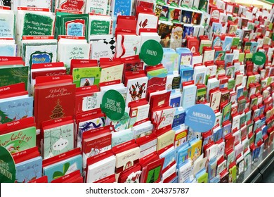 TORONTO, CANADA - NOVEMBER 30, 2013: Greeting cards on display in a store. Hallmark Cards and American Greetings are the largest producers of greeting cards in the world.