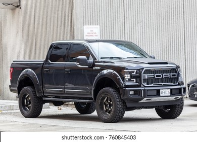 Toronto, Canada - Oct 14, 2017: Black Ford F 150 SVT Raptor Dakar Edition on a parking lot in the city of Toronto