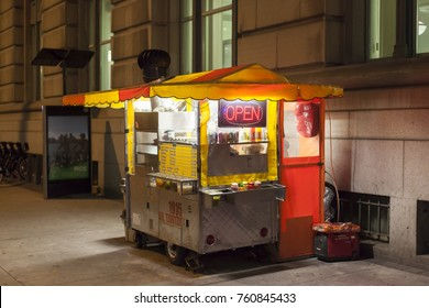 Toronto, Canada - Oct 16, 2017: Hot Dog stand in the city of Toronto illuminated at night.