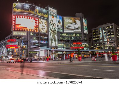 TORONTO, CANADA - OCTOBER 15, 2013: Yonge and Dundas square in Toronto at night, showing many colourful neon billboards with advertisements on October 15th 2013