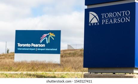 TORONTO, CANADA - October 18, 2019: GTAA (Greater Toronto Airport Authority) Toronto Pearson sign with Toronto Pearson International Airport sign in the background.