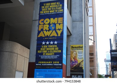 TORONTO, CANADA - October 2017 - COME FROM AWAY, musical about the September 11, 2001 attacks, broadway theatre performance, poster, art, advertisement on building, stage show, entertainment