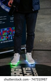 TORONTO, CANADA - OCTOBER 28, 2017: PERSON WEARING SKETCHER SHOES THAT LIGHT UP ON THE BOTTOM AT YONGE DUNDAS SQUARE.