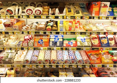 TORONTO, CANADA - OCTOBER 31, 2014: Different types of cheese on shelves in a grocery store. Hundreds of types of cheese are produced by various countries with different styles, textures and flavors.