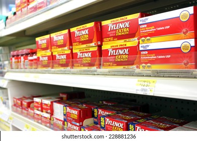TORONTO, CANADA - OCTOBER 31, 2014: Boxes of Tylenol pain reliever on shelves in a pharmacy. Tylenol is owned and distributed by McNeil Consumer Healthcare, a subsidiary of Johnson & Johnson.