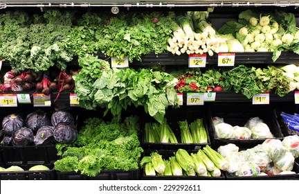 TORONTO, CANADA - OCTOBER 31, 2014: Variety of green vegetables in a supermarket. Consumption of green vegetables has increased in recent years, as more people try to follow a healthy lifestyle.