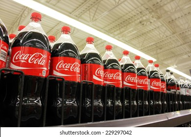 TORONTO, CANADA - OCTOBER 31, 2014: Coca Cola products on display in a grocery store. Coca Cola Company is leading manufacturer of soda drinks  in the world.