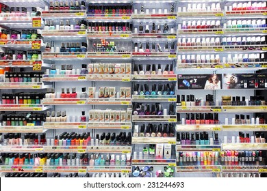 TORONTO, CANADA - OCTOBER 31, 2014: Variety of cosmetic products and nail colors on display in a department store. Nail care is one of the strongest categories of cosmetic products industry.