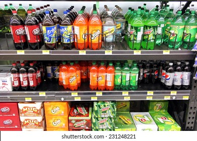 TORONTO, CANADA - OCTOBER 31, 2014: Bottled soft drinks on shelves in a supermarket. In recent years, the consumption of sweetened beverages has been doubled in North America.