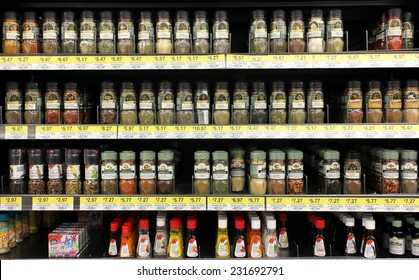 TORONTO, CANADA - OCTOBER 31, 2014: Various spices and seasoning powders on shelves in a supermarket. McCormick is one of the main  manufactures spices, herbs, and flavorings in the world.