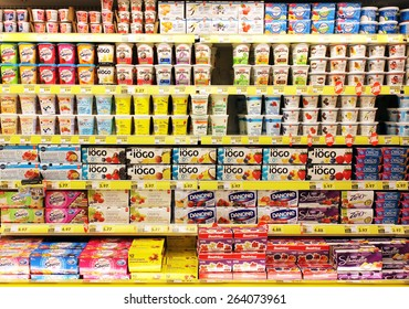 TORONTO, CANADA - OCTOBER 31, 2014: Different brands of yogurt on shelves in a supermarket. Yogurt is nutritionally rich in protein, calcium, riboflavin, vitamin B6 and vitamin B12.