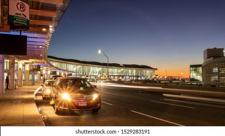 TORONTO, CANADA - October 4, 2019: Passenger drop-off area at Toronto Pearson Intl. Airport, Terminal 1 during a beautiful dusk.