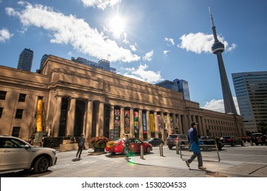 TORONTO, CANADA - October 4, 2019: CN Tower behind Toronto Union Station on a beautiful, sunny fall afternoon in Ontario's capital.