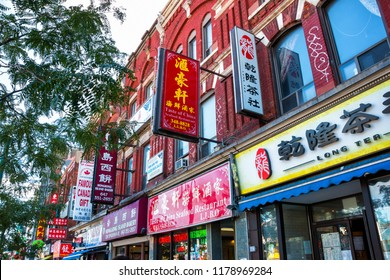 TORONTO / CANADA - SEP 12, 2018: Chinese signs for business in the China town area of Toronto along Spadina.