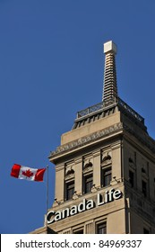TORONTO, CANADA – SEPT 18:  The Canada Life Building with a weather beacon that changes color and lighting patterns depending on the weather is a popular landmark.  Sept 18, 2011 Toronto, Ontario.