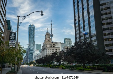TORONTO, CANADA - SEPTEMBER 01, 2018: University Avenue and Queen Street West Intersection: Canada Life building and the CN Tower top in the background